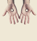 Two hands with holes. Royalty Free Stock Image