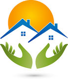 Two hands and houses, roofs, real estate and real estate agent logo Royalty Free Stock Photos