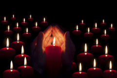 Two hands illuminated by  a candle in the darkness. Two hands illuminated by candles o a candle in a darkness background Stock Photos