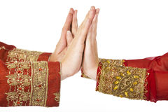 Two hands in indian dress Stock Photos