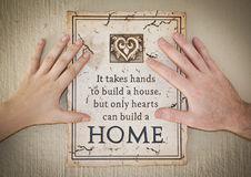 Two hands with inspirational message. On wall of a house Royalty Free Stock Image