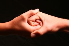 Two hands intertwined. To create a Jing Jang type symbol Royalty Free Stock Image
