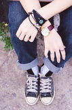 Two hands with jeans and sneakers teenage vintage style , hold h Stock Photography