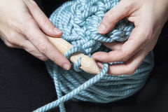 Crocheting XXL. Two hands knitting a stitch of XXL crochet Stock Photos