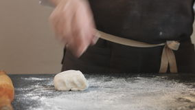 Two hands making dough for meat dumplings. stock video footage
