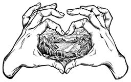 Two hands making heart sign with landscape scene. Two hands making heart sign with wilderness landscape scene with a lake, road, pine forest and mountains inside Stock Photos