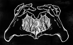 Two hands making heart sign woodland night scenery. Two hands making heart sign with woodland winter tree twigs scenery with crescent moon. Silhouette of forest Royalty Free Stock Image