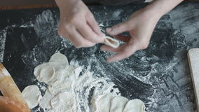 Two hands making meat dumplings. stock footage