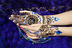 Two Hands Mehendi. Picture on hands palms, mehendi tradition decoration, resistant design by special paint, brown, black henna tattoo. Long beige nails new shape Stock Image