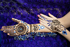 Two Hands Mehendi. Picture on hands palms, mehendi tradition decoration, resistant design by special paint, brown, black henna tattoo. Long beige nails new shape Royalty Free Stock Image