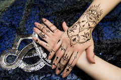Two Hands Mehendi. Picture on hands palms, mehendi tradition decoration, resistant design by special paint, brown, black henna tattoo. Long beige nails new shape Stock Photos