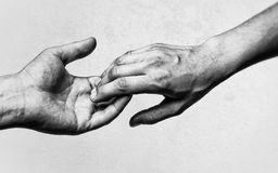 Two hands at the moment of farewell. Emotional, black and white photo of two hands at the moment of farewell. The concept of breaking relations Royalty Free Stock Photography
