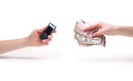 Two hands with a money and phone holding. Isolated image of a two hands with a money and phone holding Royalty Free Stock Photos