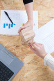 Two hands at office with blocks symbol of team Royalty Free Stock Photos