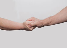 Two hands old hand in hand Royalty Free Stock Photography