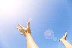 Two hands with the opened palms with sunlight Royalty Free Stock Image