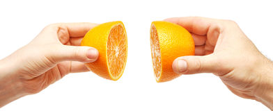 Two hands and orange Royalty Free Stock Photos