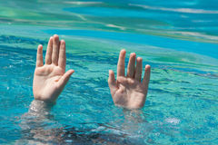 Two hands out of water Royalty Free Stock Images