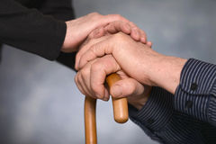 Two hands over gray background Royalty Free Stock Photos