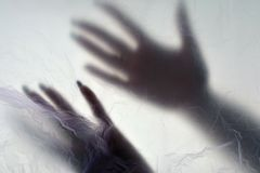 Hands in plastic bag. Dismember consept. Plastic bag background royalty free stock photography