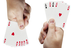 Two hands with playing cards. On a white background Stock Photography