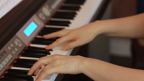 Two hands playing a gentle piece on a beautiful grand piano. stock video