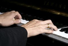 Two Hands Playing Piano Stock Images