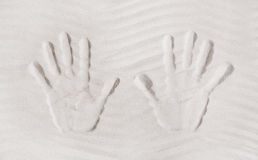 Two hands print in the sand. Concept for memories or vacation it Royalty Free Stock Photo