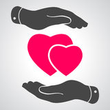 Two hands protecting pink hearts icon Royalty Free Stock Photography