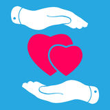 Two hands protecting pink hearts icon Stock Photos