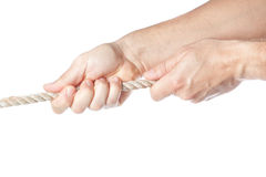 Two hands pulling a rope. On a white background royalty free stock images