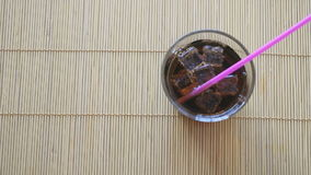 Two hands put two glasses of cola with ice. On the beech wood sticks stock video footage