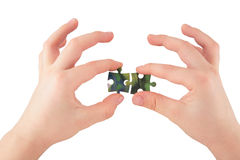 Two hands with puzzle Royalty Free Stock Photography