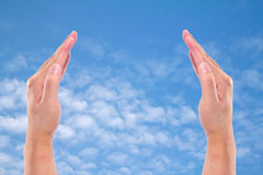 Two hands raised up Stock Image