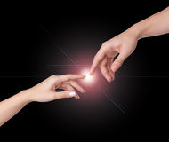 Two hands reaching for each other Royalty Free Stock Photo