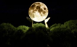 Reach for the moon stock photo