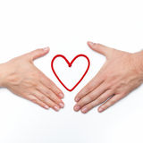 Two hands with red heart Stock Photo