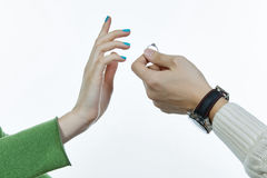 Two hands with a ring. A man is suggesting a ring to a woman, close-up of hands stock photography