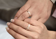 Two hands with rings on weddings day. Two hands with gold rings on weddings day Stock Images