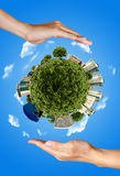 Two hands saving the earth Royalty Free Stock Image