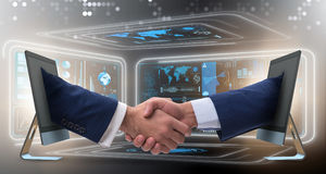 The two hands from screen in handshake concept Royalty Free Stock Photography