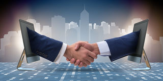 The two hands from screen in handshake concept Royalty Free Stock Photos