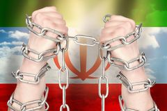 Two hands shackled a metal chain on the background of the Iran flag. Freedom concept.  stock images