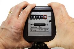 Two hands shaking with anger the counter of electrical consumpti. Two hands shaking with anger the meter of electrical consumption Royalty Free Stock Images