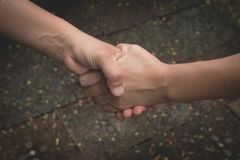 Two hands shaking each other. Teamwork and helping Stock Images