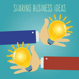 Two Hands Sharing Business Ideas Royalty Free Stock Photos