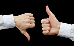Two hands showing gestures thumb up & thumb down Stock Image