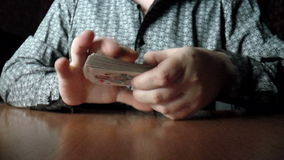 Two hands shuffling a deck of cards stock footage