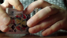 Two hands shuffling a deck of cards. The video shows hands shuffle cards stock video footage