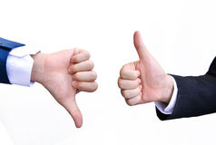 Two hands signalling thumbs up and thumbs down Royalty Free Stock Image